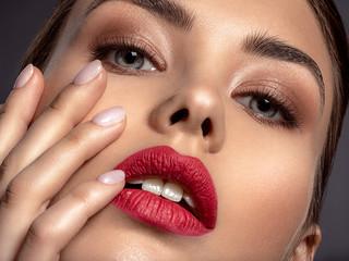 Beautiful  fashion woman with red lipstick. Pretty model.