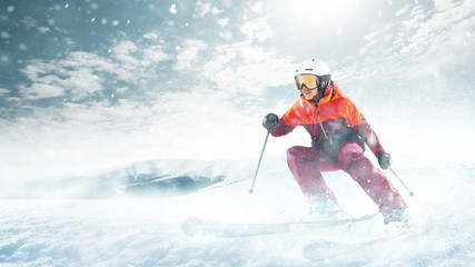 Poster Glisse hiver Young beautiful athlete woman doing winter sport - she is skiing against white alps mountain background
