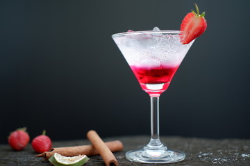 strawberry martini cocktail on table