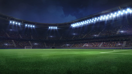 modern football stadium illuminated by floodlights and empty green grass
