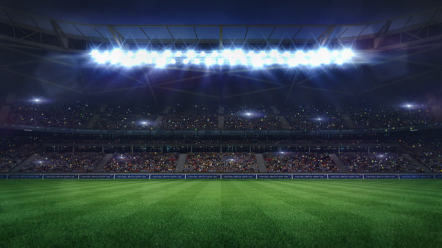 grand football stadium middle view illuminated by spotlights and empty green grass