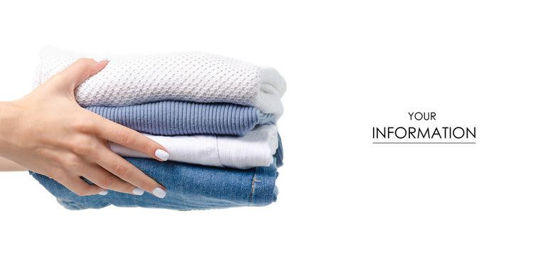 Stack of clothing jeans sweaters in hand pattern on a white background isolation