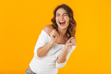 Portrait of a cheerful young woman wearing white shirt Wall mural