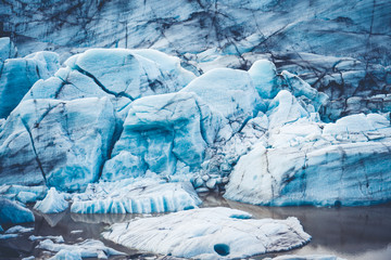 A closeup shot of a blue glacier