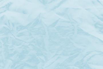 Ocean blue textile background. Silk cloth texture. Fabric pattern.
