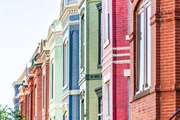 Row of colorful red green and blue painted brick residential townhouses homes houses architecture exterior in Washington DC Capitol Hill neighborhood district Fotomurales