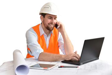 Architect / engineer at his desk planning the construction of a house - white background