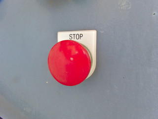 Push Button Stop Machine The button is red.
