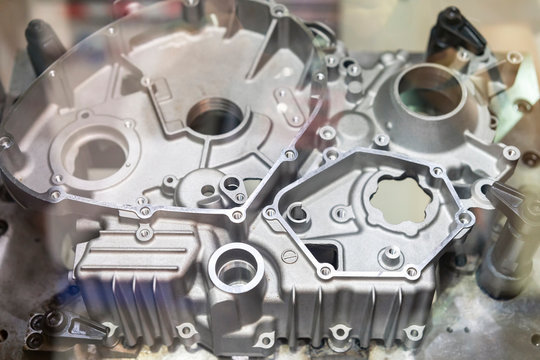 Close up Industrial aluminum casting parts cover crankcase or cylinder block of vehicle automobile or motorcycle set up on work table of machine