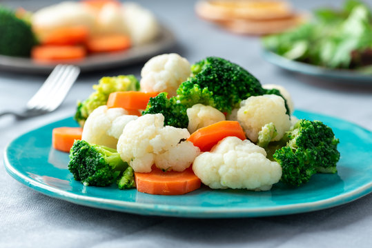 Vegetarian food, boiled vegetables. Broccoli, cauliflower and carrots.