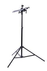 Studio light stand on white background. Photography studio flash light strobe, vertical image. Equipment for photographers.