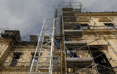 Men work on the restoration of Brazil National Museum after its devastating fire, in Rio de Janeiro