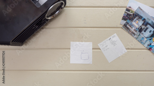 Wall mural topview Projector post it and white card with keyboard