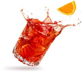Obraz orange slice falling into a splashing negroni tilted on white background - fototapety do salonu