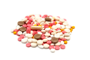 Colored pills and tablets on a white background