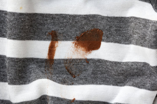 stain of chocolate sauce on dirty clothes