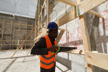 A construction worker uses a saw during the renovation project of Somalia's National Theatre in Mogadishu