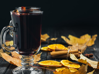 a glass of red wine mulled wine. warm autumn drink