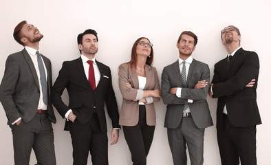 Happy positive business group looking up with dreaming expression