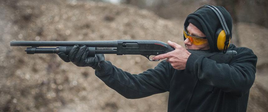 Combat shotgun shooting training. Long gun, pump gun and scattergun