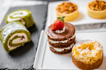 delicious strawberry and mint cakes on a white and black plate