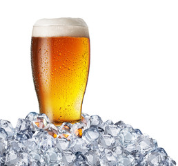 Wall Mural - Chilled glass of light beer in ice cubes. File contains clipping path.