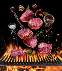 Steak cooking. Conceptual picture. Steak with spices and cutlery under burning grill grate.
