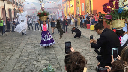 A dog takes part in a wedding celebration in Oaxaca City