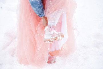 winter boots in the snow. pink womens winter boots.