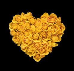 Heart shaped yellow roses isolated on black background