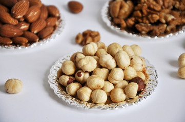mixed nuts in a bowl isolated on white background
