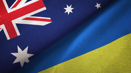 Australia and Ukraine two flags textile cloth, fabric texture