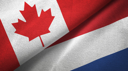 Canada and Netherlands two flags textile cloth, fabric texture Fototapete