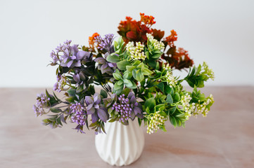 bouquet in a vase light background