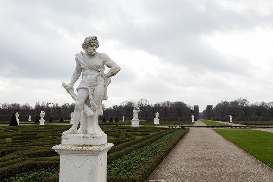herrenhausen palace statue of hercules in winter cloudy sky