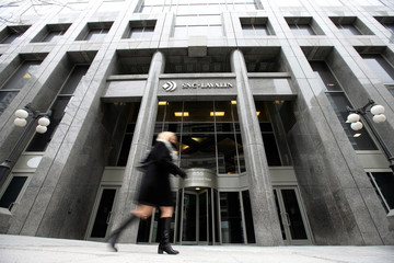 Pedestrian walks past SNC-Lavalin Group Inc., headquarters in Montreal