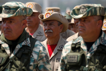 A Venezuelan militia member stands in formation during a gathering at the entrance of the Tienditas cross-border bridge between Colombia and Venezuela in Tienditas6