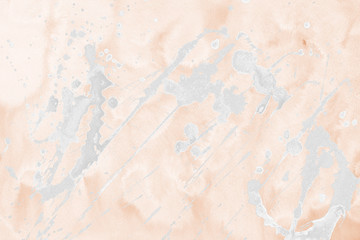 Luxury copper gold and white metal paint splatter effect on watercolor paper background. Creamy gold glitter splash texture. Beautiful feminine backdrop.