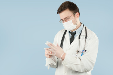 fellow doctor student removes disposable hygiene gloves by tearing them against a blue isolated background.