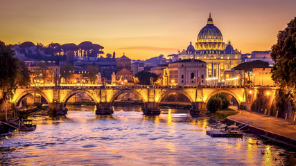 The dome of Saint Peters Basilica and Vatican City at sunset. Sant'Angelo Bridge over the Tiber River. Rome, Italy Wall mural