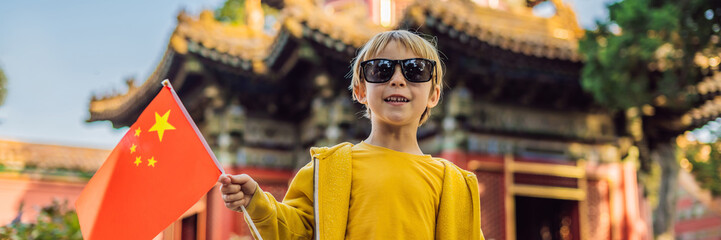Enjoying vacation in China. Young boy with national chinese flag in Forbidden City. Travel to China with kids concept. Visa free transit 72 hours, 144 hours in China BANNER, LONG FORMAT