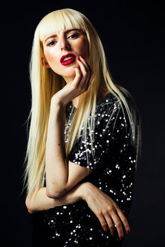 Portrait of a beautiful young woman with red nails and lips