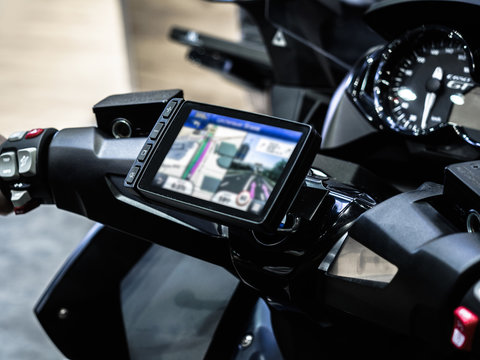 Motorcycle travel navigation on the handlebars of the bike, Finding a location on maps using the mobile on a smartphone.