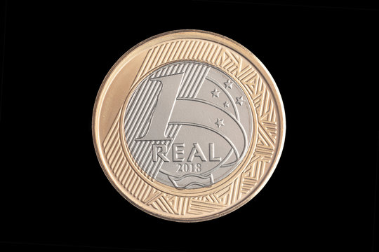 """Brazilian """"1 Real"""" 2018 coin on black background"""