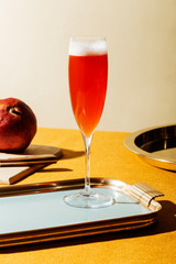 Tintoretto, an italian cocktail with 2/3 Prosecco (or Champagne) and 1/3 pomegranate juice, served in a flute. Pop contemporary style