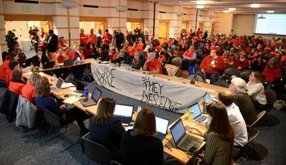 Representatives from the Denver Classroom Teachers Association and Denver Public Schools restart contract negotiations as teachers strike for a second day
