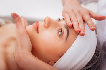 Face of a beautiful young woman during the massage