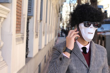 Businessman with skeleton face calling by phone
