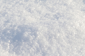 Beautiful snow covered hill detail, winter landscape. Snow surface close up and flakes background.