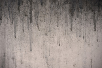 old dirty background with dripping stain on the wall, detail of texture of black trickle down on...